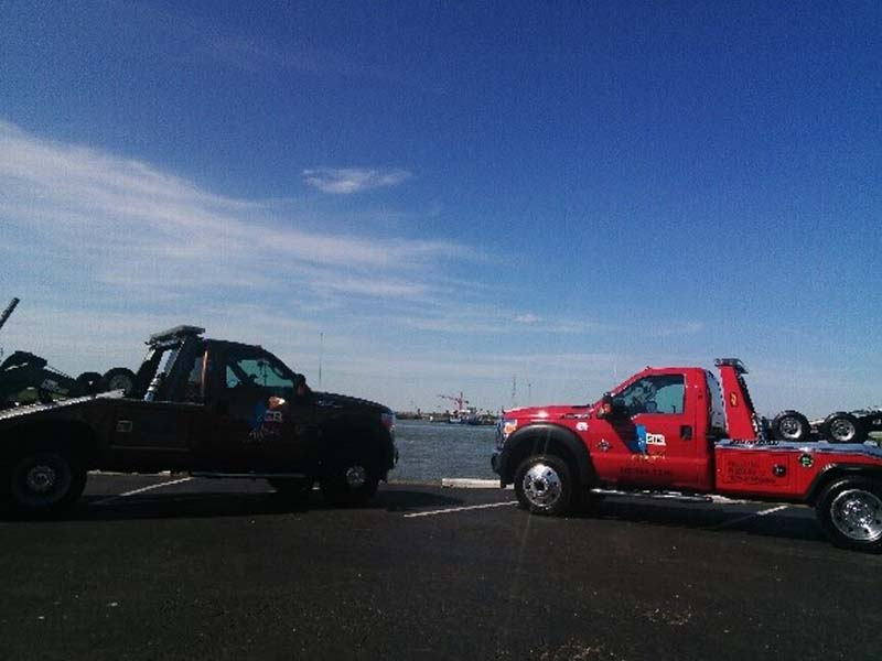 Black and red tow trucks