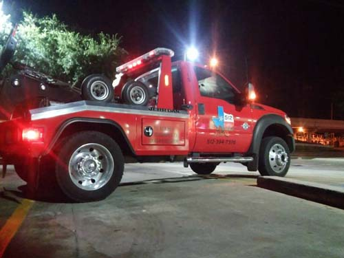 Red tow truck at night